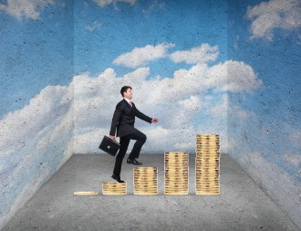 Businessman climbing on coins stack