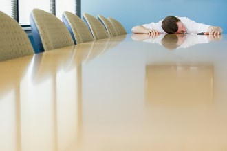 Man sleeping on conference table