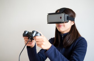 Young Woman play with the vr device