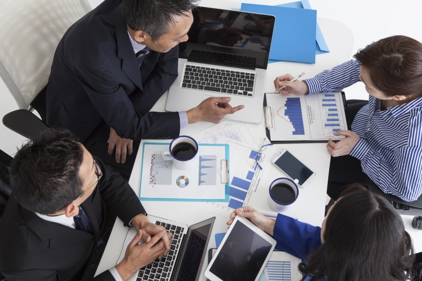 Four people have a meeting