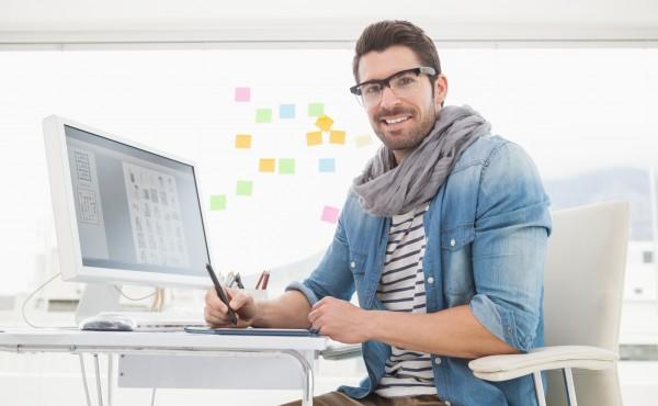 Portrait of happy designer using digitizer in the office